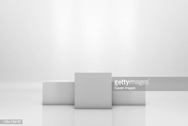 winning podium on white illuminated background - 表彰台 ストックフォトと画像