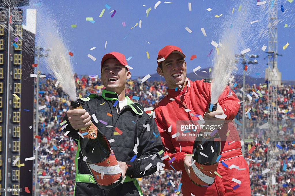 Winning race car drivers spraying champagne. : Stock Photo