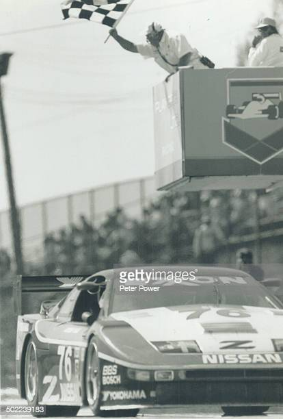 Winning ride Jeremy Dale of Toronto takes the checkered flag driving his Nissan 300ZX to Victory yesterday at Mosport Park Steve Millen was Second