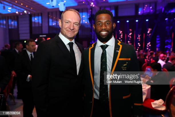 1995 winning South African Captain Francois Pienaar congratulates new World Champion South African captain Siya Kolisi during the World Rugby Awards...