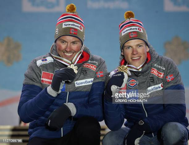 Winning team from Norway Emil Iversen and Johannes Hoesflot Klaebo pose during the medal ceremony for the men's team sprint final of the FIS Nordic...