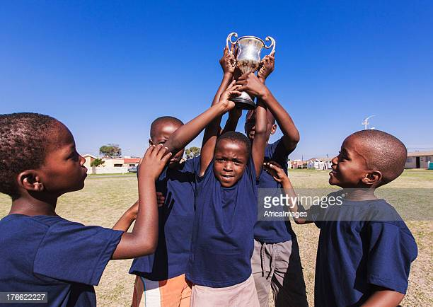 Winning team lifting trophy, Gugulethu, Cape Town, South Africa
