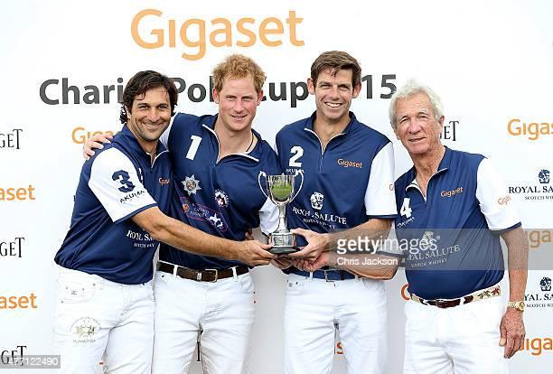 Winning team Royal Salute Eduardo Novillo Astrada Prince Harry Malcolm Borwick and Sir Charles Williams collect the winning trophy at the Gigaset...