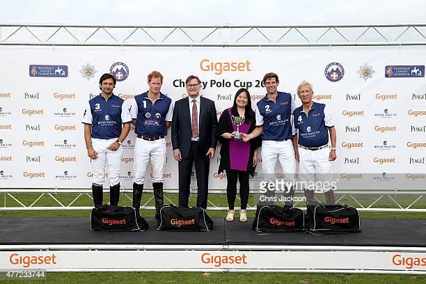 Winning team Royal Salute Eduardo Novillo Astrada Prince Harry Malcolm Borwick and Sir Charles Williams collect the winning trophy with Charles...