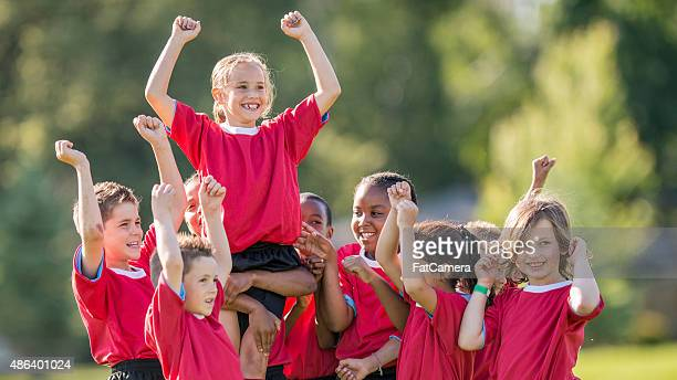 winning the championship game - scoring a goal stock pictures, royalty-free photos & images