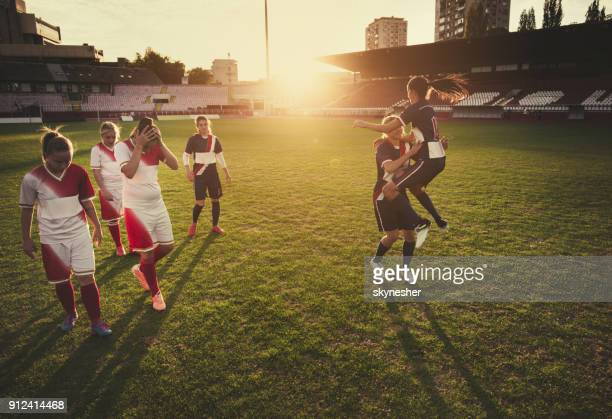 winning vs. loosing on women's soccer match! - defeat stock photos and pictures