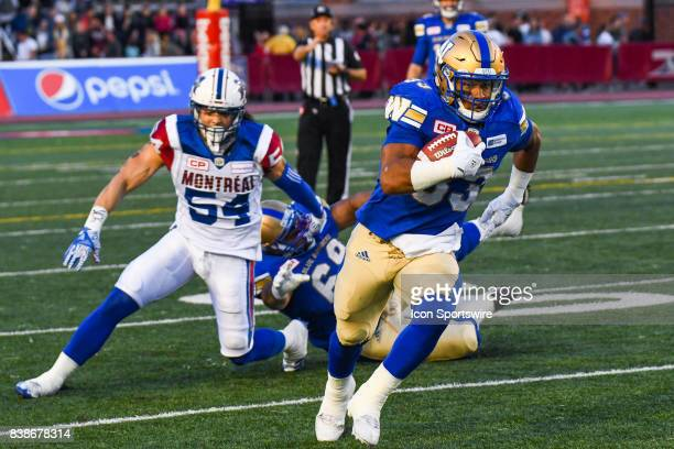 Winnipeg Blue Bombers running back Andrew Harris running away with the ball during the Winnipeg Blue Bombers versus the Montreal Alouettes game on...