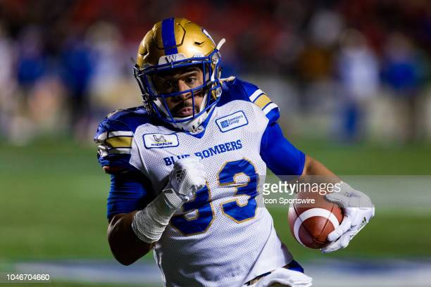 Winnipeg Blue Bombers running back Andrew Harris runs the football during Canadian Football League action between the Winnipeg Blue Bombers and...