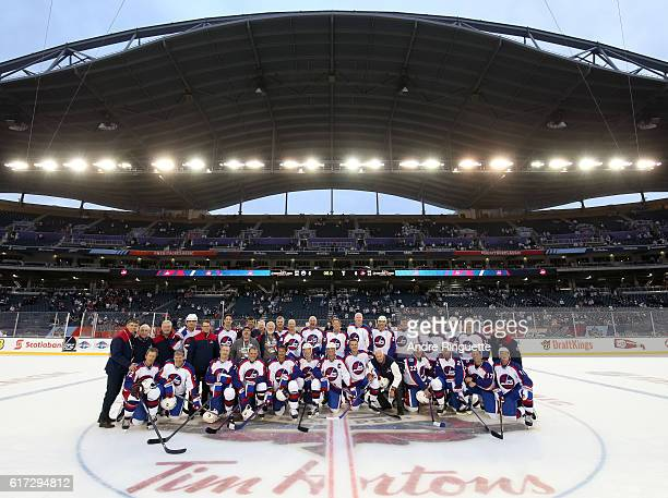 Winnipeg Jets alumni and staff pose for a photo during the 2016 Tim Hortons NHL Heritage Classic alumni game at Investors Group Field on October 22...