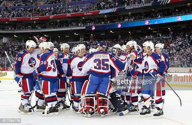 Winnipeg Jets alumni celebrate after a 65 win over Edmonton Oilers alumni during the 2016 Tim Hortons NHL Heritage Classic alumni game at Investors...