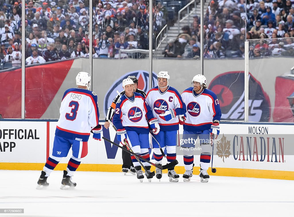 Winnipeg Jets alumni celebrate after a first period goal on Edmonton Oilers alumni during the 2016 Tim Hortons NHL Heritage Classic alumni game at Investors Group Field on October 22, 2016 in Winnipeg, Canada.