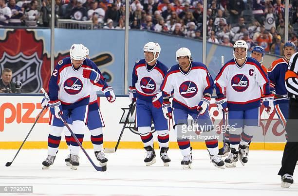 Winnipeg Jets alumni celebrate after a goal on Edmonton Oilers alumni during the 2016 Tim Hortons NHL Heritage Classic alumni game at Investors Group...
