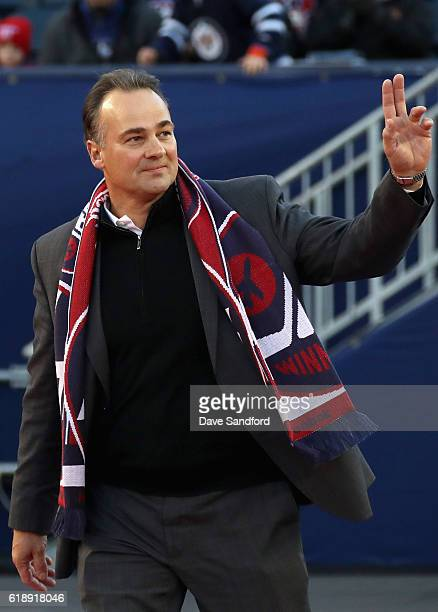 Winnipeg Jets alumni Dale Hawerchuk waves to the crowd from the field during the second intermission of the 2016 Tim Hortons NHL Heritage Classic...