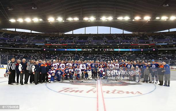 Winnipeg Jets alumni Edmonton Oilers alumni and game officials pose for a photo during the 2016 Tim Hortons NHL Heritage Classic alumni game at...