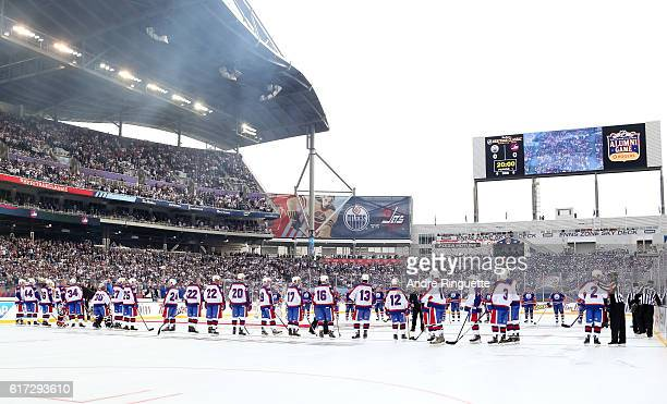 Winnipeg Jets alumni line up for the Canadian national anthem during the 2016 Tim Hortons NHL Heritage Classic alumni game at Investors Group Field...