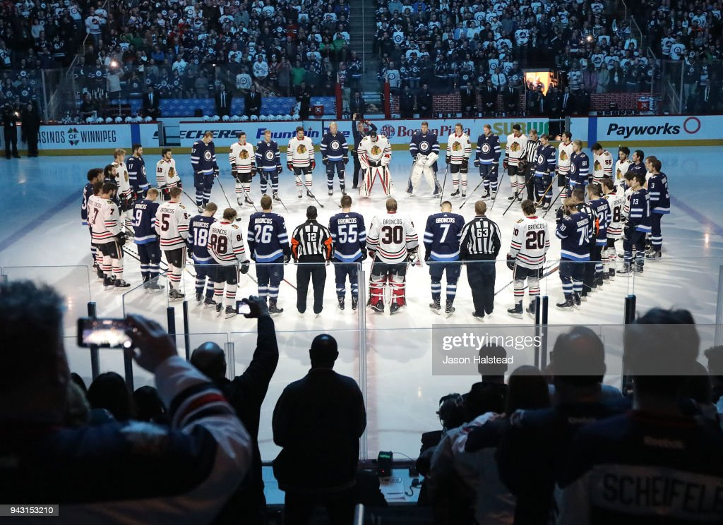 Winnipeg Jets and Chicago Blackhawks players honour those involved in the Humboldt Broncos bus crash tragedy before NHL action on April 7, 2018 at Bell MTS Place in Winnipeg, Manitoba.