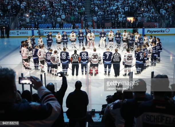Winnipeg Jets and Chicago Blackhawks players honour those involved in the Humboldt Broncos bus crash tragedy before NHL action on April 7, 2018 at...