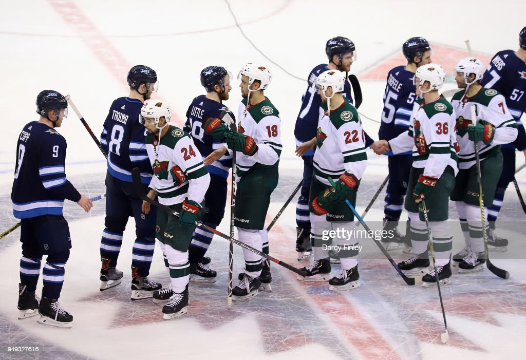 Winnipeg Jets and Minnesota Wild players shake hands following a 5-0 Jets victory in Game Five of the Western Conference First Round during the 2018 NHL Stanley Cup Playoffs at the Bell MTS Place on April 20, 2018 in Winnipeg, Manitoba, Canada. The Jets win the series 4-1.