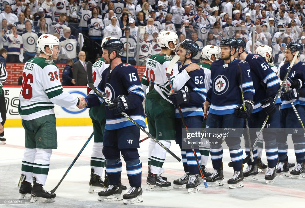 Winnipeg Jets and Minnesota Wild players take part in the handshake line following a 5-0 Jets victory in Game Five of the Western Conference First Round during the 2018 NHL Stanley Cup Playoffs at the Bell MTS Place on April 20, 2018 in Winnipeg, Manitoba, Canada. The Jets win the series 4-1.