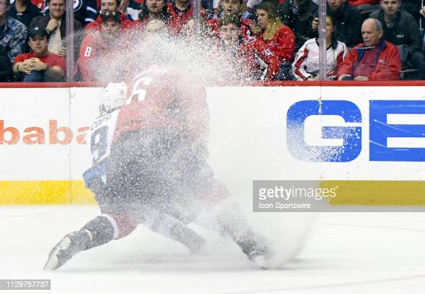 Winnipeg Jets center Andrew Copp skates away from Washington Capitals defenseman Michal Kempny on March 10 at the Capital One Arena in Washington DC