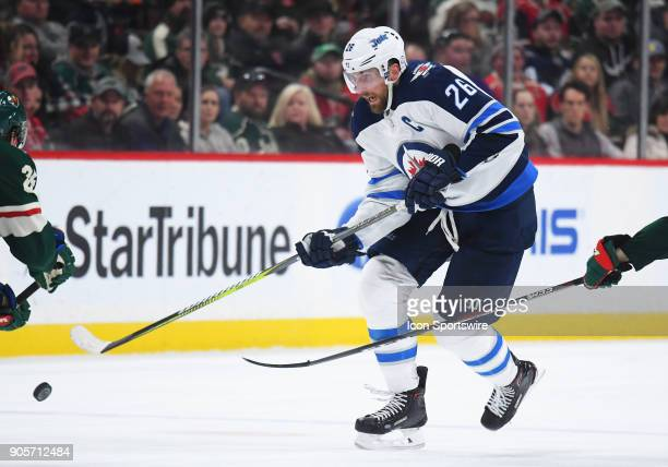 Winnipeg Jets Center Blake Wheeler chips the puck up ice during a NHL game between the Minnesota Wild and Winnipeg Jets on January 13 2018 at Xcel...
