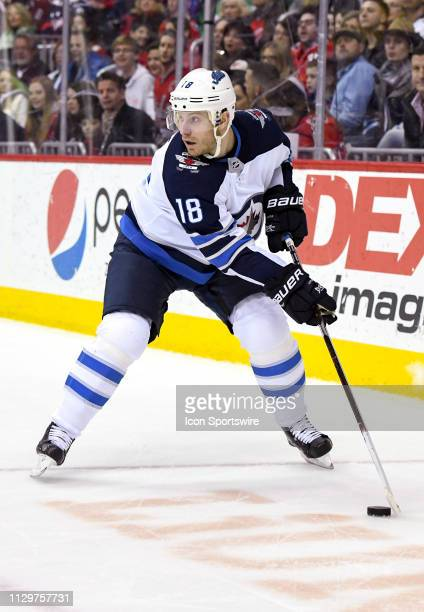 Winnipeg Jets center Bryan Little brings the puck up ice in the first period against the Washington Capitals on March 10 at the Capital One Arena in...