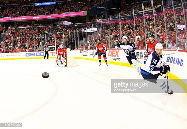 Winnipeg Jets center Bryan Little goes for a puck against the board in the first period agains the Washington Capitals on March 10 at the Capital One...