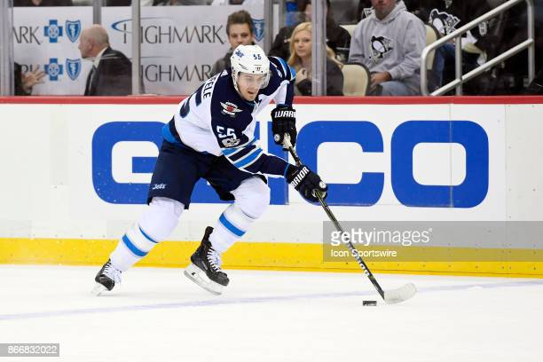 Winnipeg Jets Center Mark Scheifele skates with the puck during the first period in the NHL game between the Pittsburgh Penguins and the Winnipeg...