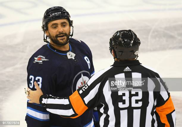 Winnipeg Jets Defenceman Dustin Byfuglien has words for New York Rangers Left Wing Cody McLeod during a NHL game between the Winnipeg Jets and New...