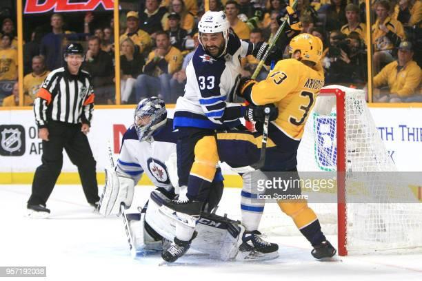 Winnipeg Jets defenseman Dustin Byfuglien and Nashville Predators right wing Viktor Arvidsson battle for position in front of Winnipeg Jets goalie...