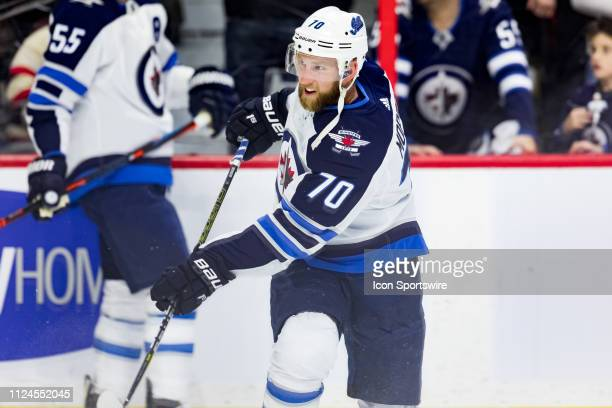 Winnipeg Jets defenseman Joe Morrow takes a shot during warmup before National Hockey League action between the Winnipeg Jets and Ottawa Senators on...