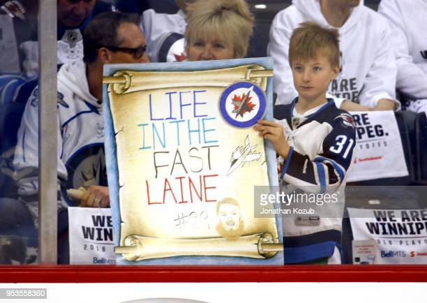 Winnipeg Jets fan holds up a sign during the pregame warm up prior to NHL action against the Nashville Predators in Game Three of the Western...