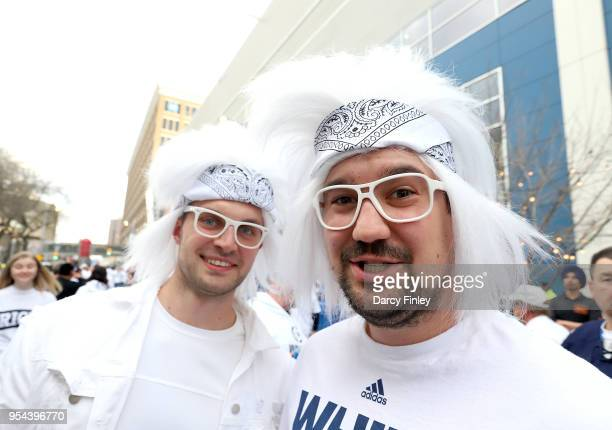 Winnipeg Jets fans clad in all white take part in the Whiteout Street Party prior to NHL action between the Jets and the Nashville Predators in Game...