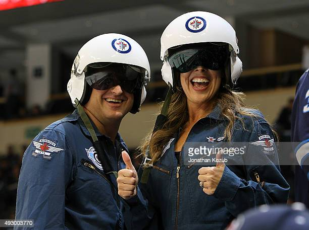Winnipeg Jets fans decked out in full flight gear gives the thumbs up prior to NHL action between the Jets and the Calgary Flames at the MTS Centre...