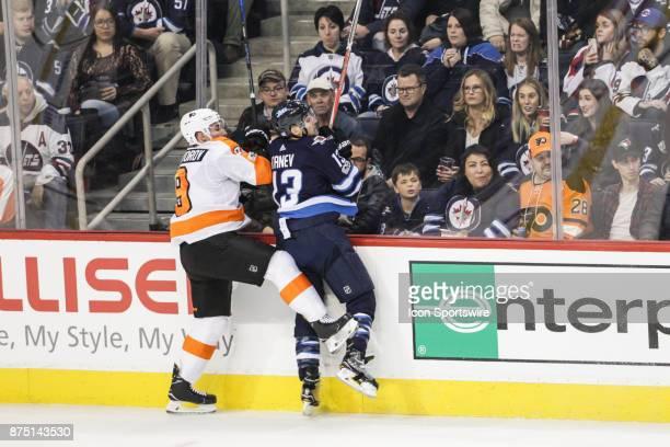 Winnipeg Jets forward Brandon Tanev bodies Philadelphia Flyers defenseman Ivan Provorov during the NHL game between the Winnipeg Jets and the...