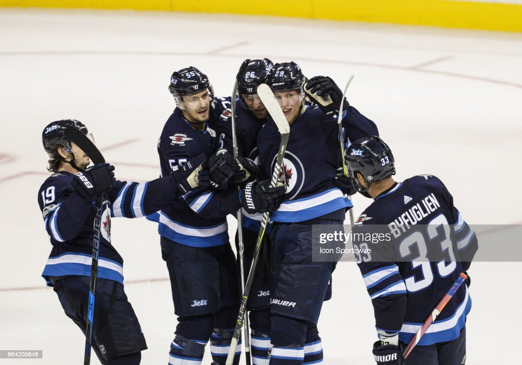 Winnipeg Jets forward Patrik Laine (29) is congratulated on his goal during the NHL game between the Winnipeg Jets and the Minnesota Wild on October 20, 2017 at the Bell MTS Place in Winnipeg MB.