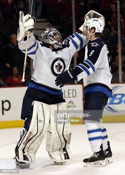 Winnipeg Jets goalie Al Montoya and teammate Jacob Trouba celebrate a 31 win over the Chicago Blackhawks at the United Center in Chicago on Sunday...