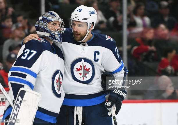 Winnipeg Jets Goalie Connor Hellebuyck and Winnipeg Jets Center Blake Wheeler chat during a TV timeout during a NHL game between the Minnesota Wild...
