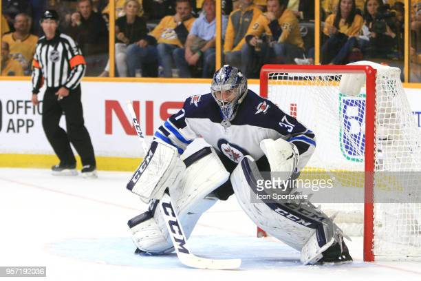 Winnipeg Jets goalie Connor Hellebuyck is shown during Game Seven of Round Two of the Stanley Cup Playoffs between the Nashville Predators and...