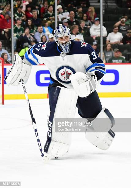 Winnipeg Jets goalie Connor Hellebuyck skates to the bench for an extra skater during a preseason NHL game between the Minnesota Wild and Winnipeg...