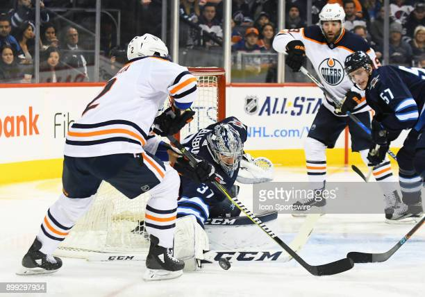 Winnipeg Jets Goalie Connor Hellebuyck stops Edmonton Oilers Defenceman Andrej Sekera during a NHL game between the Winnipeg Jets and Edmonton Oilers...
