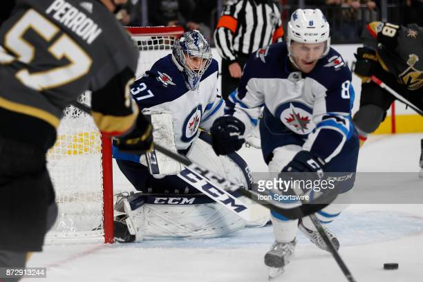 Winnipeg Jets Goalie Connor Hellebuyck watches the centering pass cross in front of him during a game between the Vegas Golden Knights and the...