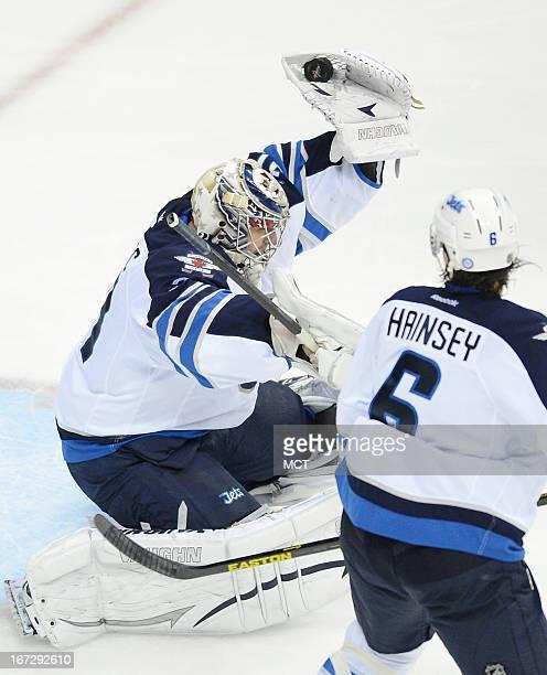 Winnipeg Jets goalie Ondrej Pavelec makes a glove save against the Washington Capitals in the third period at the Verizon Center in Washington DC...