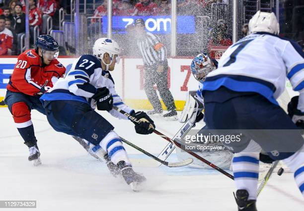Winnipeg Jets goaltender Connor Hellebuyck makes a second period save on shot by Washington Capitals center Lars Eller on March 10 at the Capital One...