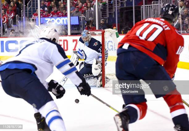 Winnipeg Jets goaltender Connor Hellebuyck makes a second period save on shot by Washington Capitals right wing Brett Connolly on March 10 at the...