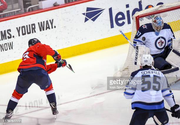 Winnipeg Jets goaltender Connor Hellebuyck makes a third period save on shot by Washington Capitals left wing Jakub Vrana on March 10 at the Capital...