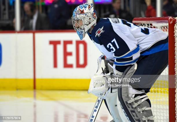 Winnipeg Jets goaltender Connor Hellebuyck stands in goal in the second period against the Washington Capitals on March 10 at the Capital One Arena...