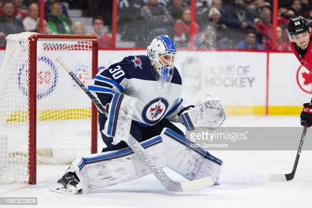 Winnipeg Jets goaltender Laurent Brossoit prepares to make a save during second period National Hockey League action between the Winnipeg Jets and...
