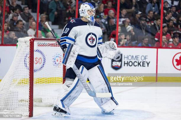 Winnipeg Jets goaltender Laurent Brossoit waits for the play during second period National Hockey League action between the Winnipeg Jets and Ottawa...