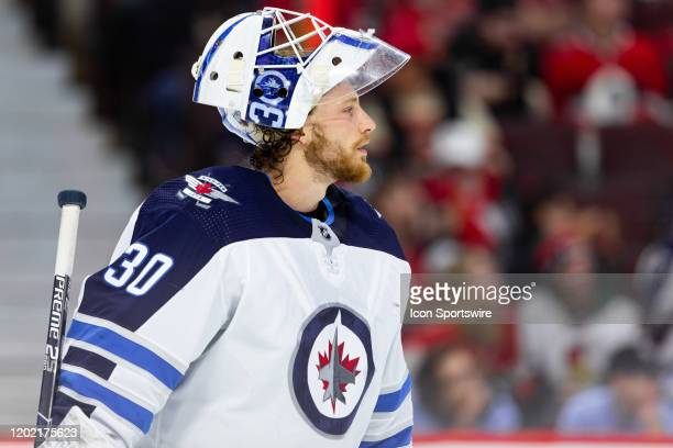 Winnipeg Jets goaltender Laurent Brossoit with his mask up after a whistle during second period National Hockey League action between the Winnipeg...